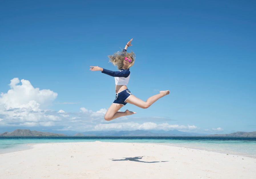 girl jumping into action - Her Business Listings